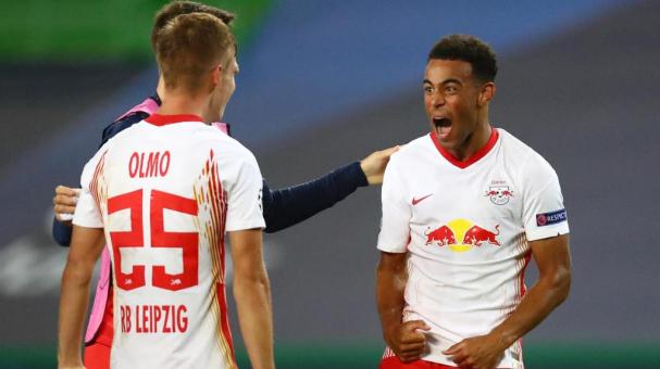 Dani Olmo of RB Leipzig and Tyler Adams of RB Leipzig celebrate in the UEFA Champions League Quarter Final match between RB Leipzig and Club Atletico de Madrid at Estadio Jose Alvalade on August 13, 2020 in Lisbon, Portugal. (Getty Images)