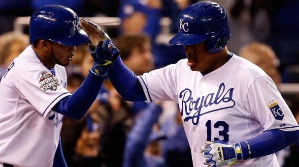 Salvador Perez #13 celebrates with Alcides Escobar #2 Kansas City Royals after scoring a run in the eighth inning against the New York Mets in Game Two of the 2015 World Series at Kauffman Stadium on October 28, 2015 in Kansas City, Missouri. Getty Images