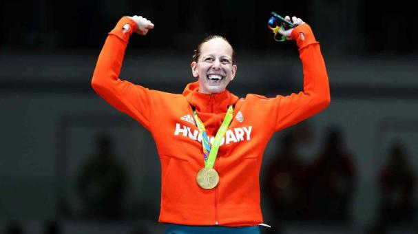 RIO DE JANEIRO, BRAZIL - AUGUST 06: Emese Szasz of Hungary celebrates on the podium after winning the Women's Epee Individual Gold Medal on Day 1 of the Rio 2016 Olympic Games at Carioca Arena 3 on August 6, 2016 in Rio de Janeiro, Brazil. (Photo by Ryan