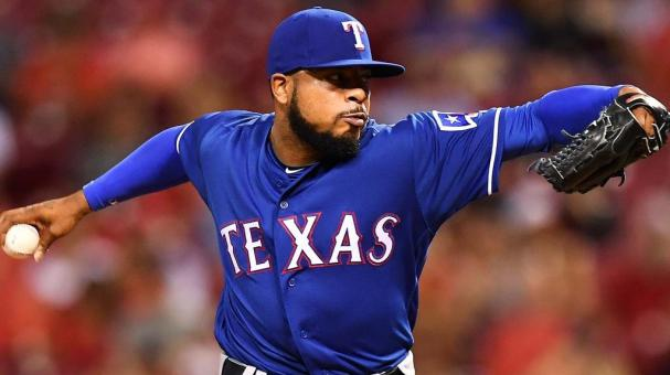 Jeremy Jeffress #23 of the Texas Rangers pitches in the seventh inning against the Cincinnati Reds at Great American Ball Park on August 23, 2016 in Cincinnati, Ohio. Cincinnati defeated Texas 3-0. (Photo by Jamie Sabau/Getty Images)