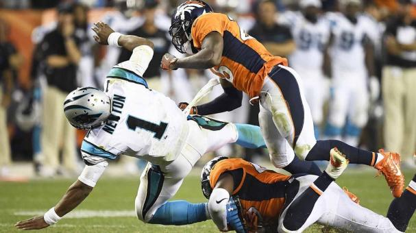 Shaquil Barrett (48) of the Denver Broncos and Darian Stewart (26) hit Cam Newton (1) of the Carolina Panthers hard during the fourth quarter of the Broncos' 21-20 win on Thursday, September 8, 2016. (Photo by John Leyba/The Denver Post via Getty Images)