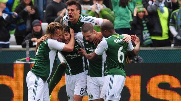 Portland Timbers teammates mob Diego Valeri #8 of Portland Timbers after Valeri scored a goal. (Photo by Steve Dykes/Getty Images)