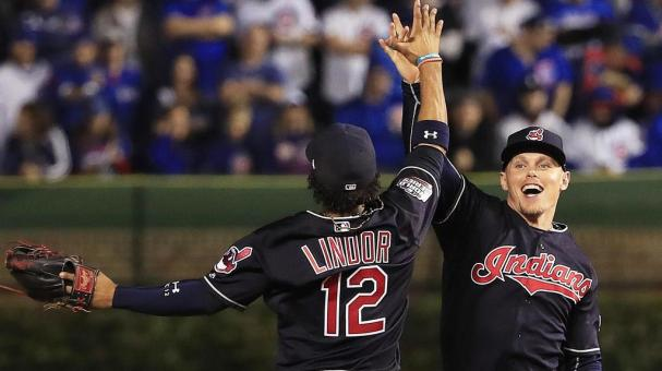 Cleveland Indians Francisco Lindor (L) and Brandon Guyer (R) celebrate after defeating the Chicago Cubs in game three of the World Series at Wrigley Field in Chicago, Illinois, USA, 28 October 2016. (Photo by Elsa/Getty Images)