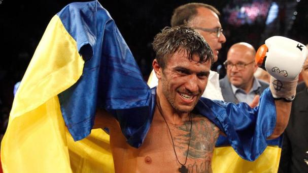 WBO featherweight champion Vasyl Lomachenko (C) makes a face after defeating Romulo Koasicha in their title fight at the Thomas & Mack Center on November 7, 2015 in Las Vegas, Nevada. Lomachenko defended his title with a 10th-round KO. (Getty Images)