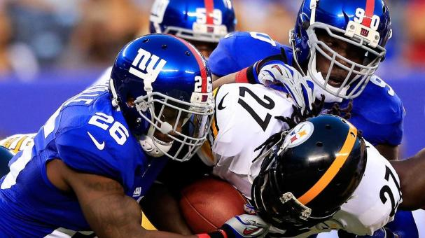 LeGarrette Blount #27 of the Pittsburgh Steelers is tackled by Antrel Rolle #26 of the New York Giants at MetLife Stadium on August 9, 2014 in East Rutherford, New Jersey. (Photo by Alex Trautwig/Getty Images)