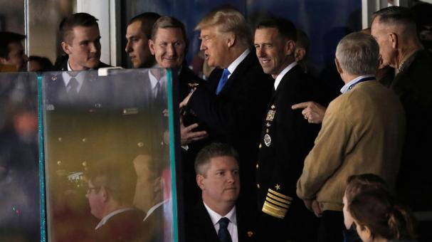 U.S. President-elect Donald Trump stands with U.S. Navy personnel as he watches the Army vs Navy college football game at M&T Bank Stadium in Baltimore, Maryland, December 10, 2016. REUTERS/Mike Segar