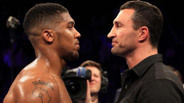 Wladimir Klitschko of Ukraine looks at Anthony Joshua of England (L) following the announcement that the pair will fight at Wembley Stadium in April 2017, at Manchester Arena on December 10, 2016 in Manchester, England. (Getty Images)