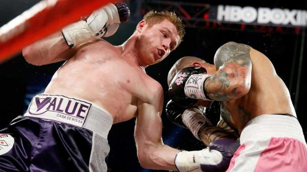 Canelo Alvarez throws a left at Miguel Cotto during their middleweight fight at the Mandalay Bay Events Center on November 21, 2015 in Las Vegas, Nevada.  (Photo by Isaac Brekken/Getty Images)