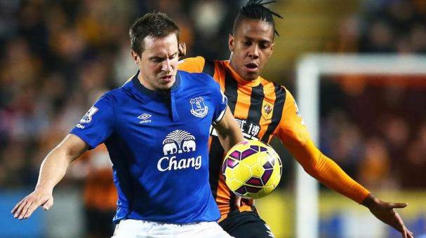 Phil Jagielka of Everton is closed down by Abel Hernandez of Hull City during the Barclays Premier League match between Hull City and Everton at KC Stadium on January 1, 2015 in Hull, England. (Getty Images)
