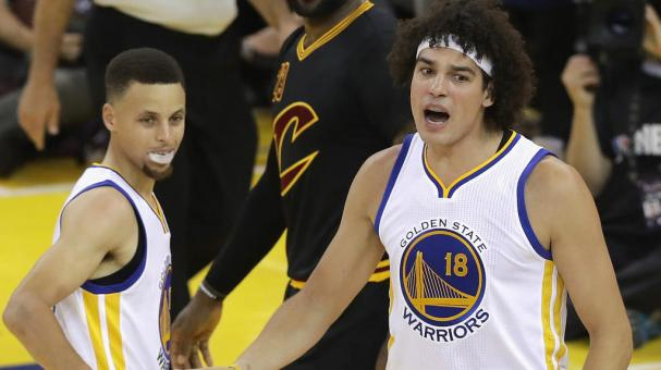 Stephen Curry #30 of Golden State Warriors and Anderson Varejao #18 react in Game 5 of the 2016 NBA Finals at ORACLE Arena on June 13, 2016 in Oakland, California. (Getty Images)