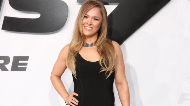 """Ronda Rousey arrives at the premiere of """"Furious 7"""" at the TCL Chinese Theatre IMAX in Los Angeles. Paramount Pictures said Monday, Aug. 3. (Photo AP)"""