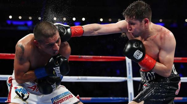 Carlos Cuadras and David Carmona exchange punches during their junior bantamweight bout at Madison Square Garden on March 18, 2017 in New York City. (Photo by Al Bello/Getty Images)