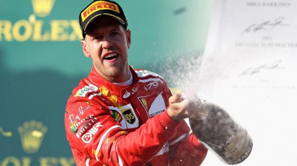 Sebastian Vettel of Germany driving the (5) Scuderia Ferrari SF70H celebrates his win on the podium during the Australian Formula One Grand Prix at Albert Park on March 26, 2017 in Melbourne, Australia. (Getty Images)