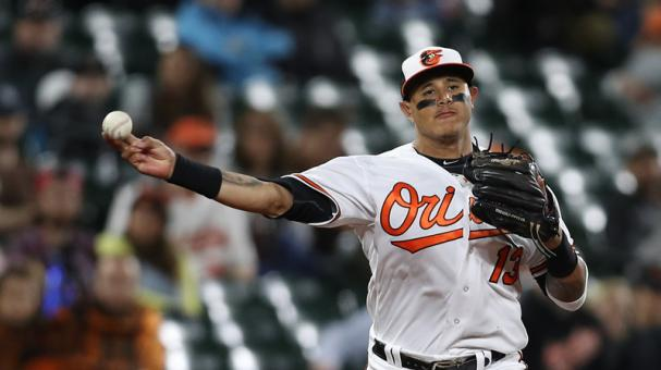 Manny Machado y Seth Smith guían reacción de Orioles ante Yankees