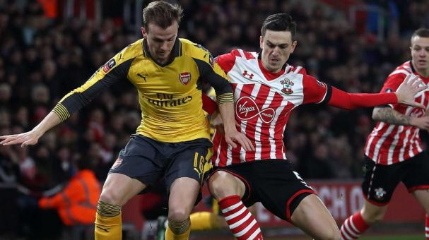 Florin Gardos of Southampton tackles Rob Holding of Arsenal at  St Mary's Stadium on January 28, 2017 in Southampton, England. (Photo by Julian Finney/Getty Images)