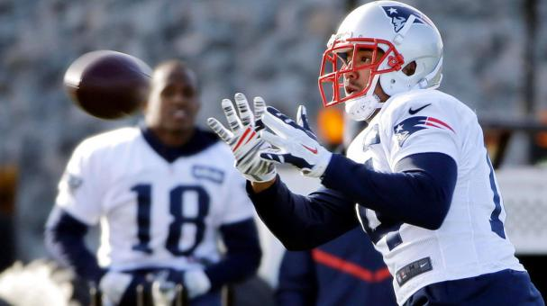 New England Patriots wide receiver Michael Floyd catches a pass as Matthew Slater (18) looks on during an NFL football team practice Wednesday, Dec. 21, 2016, in Foxborough, Mass. (AP Photo)