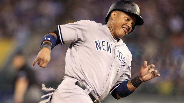 Starlin Castro #14 of the New York Yankees runs home to score on a hit off the bat of Jacoby Ellsbury in the seventh inning against the Kansas City Royals at Kauffman Stadium on May 16, 2017 in Kansas City, Missouri. (Getty Images)