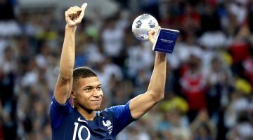 Kylian Mbappe of France celebrates with the Best Young Player trophy after the FIFA World Cup 2018 final between France and Croatia in Moscow, Russia, 15 July 2018. EFE
