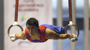 Jossimar Calvo of Colombia competes on the rings. (Getty Images)