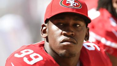 Aldon Smith #99 of the San Francisco 49ers looks on from the bench against the San Diego Chargers during the fourth quarter of a preseason game on August 24, 2014 in Santa Clara, California. (Getty Images)