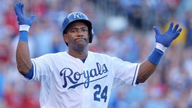 The Kansas City Royals' Miguel Tejada throws up his hands after flying out to end the first inning against the Boston Red Sox on Saturday, August 10, 2013, at Kauffman Stadium in Kansas City, Missouri. (Getty Images)