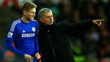 Jose Mourinho, manager of Chelsea speaks with Andre Schurrle of Chelsea. (Photo by Richard Heathcote/Getty Images)