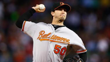 Miguel Gonzalez #50 of the Baltimore Orioles pitches against the Boston Red Sox in the first inning during the game at Fenway Park on September 8, 2014 in Boston, Massachusetts. (Getty Images)