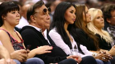 Team owner Donald Sterling of the Los Angeles Clippers and V. Stiviano watch the Western Conference Finals of the 2013 NBA Playoffs at AT&T Center on May 19, 2013 in San Antonio, Texas. Getty Images