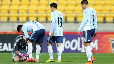 Augusto Batalla of Argentina is consoled by teammate Cristian Pavon, while Emiliano Buendia and Leonardo Rolon look on during the FIFA U-20 World Cup New Zealand 2015 Group B match between Austria and Argentina at Wellington Regional Stadium. Getty Images