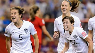 Kelley O'Hara #5 of the United States celebrates with teammates after scoring a goal in the second half against Germany in the FIFA Women's World Cup 2015 Semi-Final Match at Olympic Stadium on June 30, 2015 in Montreal, Canada. (Getty Images)