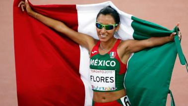 Brenda Flores of Mexico celebrates after she won the women's 10000 meter final during Day 13 of the Toronto 2015 Pan Am Games on July 23, 2015 in Toronto, Canada. (Getty Images)