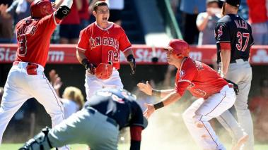 Taylor Featherston #8 of the Los Angeles Angels reacts to his run off of a wild pitch by Cody Allen #37 of the Cleveland Indians celebrates a 4-3 win during the 9th inning at Angel Stadium of Anaheim on August 5, 2015 in Anaheim, California. (Getty Images