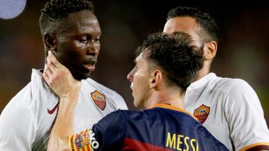 AS Roma's Mapou Yanga-Mbiwa (L) and Barcelona's Lionel Messi (R) touch heads during the 50th Joan Gamper Trophy football match FC Barcelona vs AS Roma at the Camp Nou stadium in Barcelona on August 5, 2015. (QUIQUE GARCIA/AFP/Getty Images)