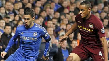 Chelsea's Belgian midfielder Eden Hazard (L) vies with Manchester City's Belgian defender Vincent Kompany during the English Premier League at Stamford Bridge in London on November 25, 2012. Getty Images