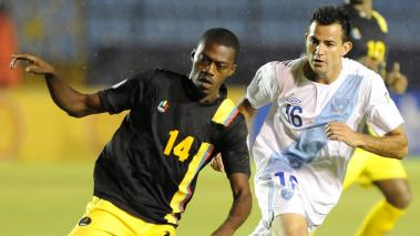 Caption:Antigua and Bermuda player Randolph Burton (L) vies for the ball with Guatemala's Marco Pappa during their FIFA World Cup Brazil 2014 CONCACAF qualifier football match at the Mateo Flores stadium in Guatemala City. Getty Images