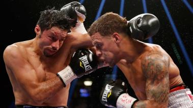 Jhonny Gonzalez and Jonathan Oquendo trade punches during their super featherweight fight at MGM Grand Garden Arena on September 12, 2015 in Las Vegas, Nevada. (Getty Images)