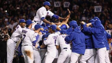 The Chicago Cubs celebrate defeating the St. Louis Cardinals 6-4 in game four of the National League Division Series at Wrigley Field on October 13, 2015 in Chicago, Illinois. (Photo by Jonathan Daniel/Getty Images)