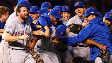 Jeurys Familia #27 of the New York Mets celebrates with his teammates after defeating the Chicago Cubs in game four of the 2015 MLB National League Championship Series at Wrigley Field on October 21, 2015 in Chicago, Illinois. Getty Images