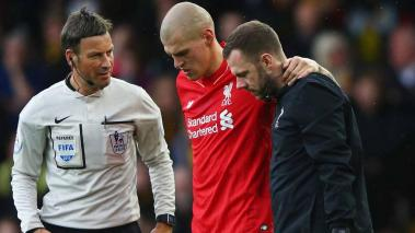 Referee Mark Clattenburg looks on as an injured Martin Skrtel of Liverpool is given assistance as he is substituted during the Barclays Premier League match between Watford and Liverpool at Vicarage Road on December 20, 2015 in Watford, England. Getty
