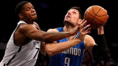 Nikola Vucevic #9 of the Orlando Magic heads for the net as Joe Johnson #7 of the Brooklyn Nets defends at Barclays Center on December 14, 2015 in the Brooklyn borough of New York City. (Getty Images)
