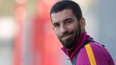 Barcelona's Turkish midfielder Arda Turan looks on as he arrives to take part in a training session at the Sports Center FC Barcelona Joan Gamper in Sant Joan Despi, near Barcelona on January 16, 2016. (JOSEP LAGO/AFP/Getty Images)