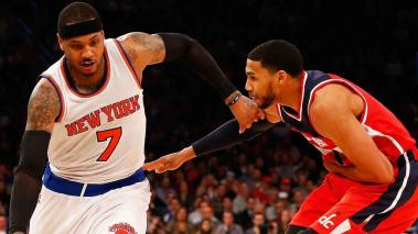 Carmelo Anthony #7 of the New York Knicks drives against Garrett Temple #17 of the Washington Wizards during their game at Madison Square Garden on February 9, 2016 in New York City. (Getty Images)