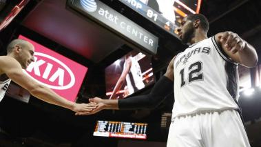 LaMarcus Aldridge #12 of the San Antonio Spurs gets congratulates from Manu Ginobili #20 of the San Antonio Spurs at AT&T Center on February 3, 2016 in San Antonio, Texas. Getty Images