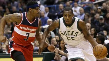 Khris Middleton #22 of the Milwaukee Bucks drives to the hoop for two points during the first quarter against the Washington Wizards at BMO Harris Bradley Center on February 11, 2016 in Milwaukee, Wisconsin. (Getty Images)