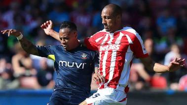 Nathaniel Clyne of Southampton challenges Steven Nzonzi of Stoke during the Barclays Premier League at the Britannia Stadium on April 18, 2015 in Stoke on Trent, England. (Photo by Dave Thompson/Getty Images)