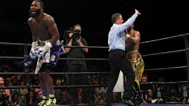 Adrien Broner (L) reacts after defeating Ashley Theophane (R) by TKO in ninth round in their super lightweight championship bout at the DC Armory on April 1, 2016 in Washington, DC. (Getty Images)