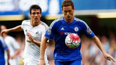 Nemanja Matic of Chelsea and Jack Cork of Swansea City compete for the ball during the Barclays Premier League match between Chelsea and Swansea City at Stamford Bridge on August 8, 2015 in London, England. (Photo by Julian Finney/Getty Images)
