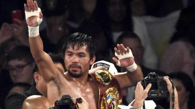 Manny Pacquiao of the Philippines celebrates after defeating Timothy Bradley of the USA in their WBO International Welterweight Championship title at the MGM Grand Garden Arena in Las Vegas, Nevada, USA, 09 April 2016. (Filipinas, Estados Unidos) EFE
