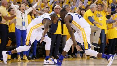 Andre Iguodala #9 and Draymond Green #23 of the Golden State Warriors celebrate over the Portland Trail Blazers in Game Two of the Western Conference Semifinals 2016 NBA Playoffs on May 3, 2016 at Oracle Arena in Oakland, California. Getty Images