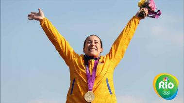 Gold medallist Mariana Pajon of Colombia celebrates during the medal ceremony for the Women's BMX Cycling Final on Day 14 of the London 2012 Olympic Games at the BMX Track on August 10, 2012 in London, England. (Photo by Bryn Lennon/Getty Images)